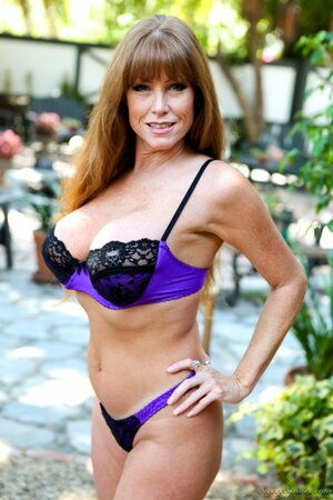 Mature cougar Darla Crane teases with busty body in sexy lingerie outside