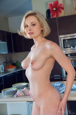 Babe can't deny sexual drive and gets naked to rub snatch in the kitchen