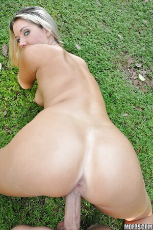 Blue-eyed blonde bimbo owned into hairy cunt on the grass in POV pictures