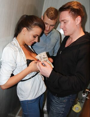 Excited mates find a favored girl and give her money for threesome in restroom