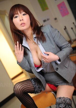 Far eastern businesswoman wears too hot stockings and furthermore red underwear under office outfit