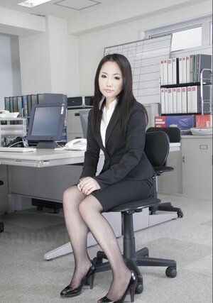 Pretty Asiatic office kitten in black stockings is ready to show off hairy cunt