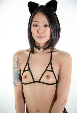Erotically attractive Oriental kitty with tiny boobs doesn't mind being obedient
