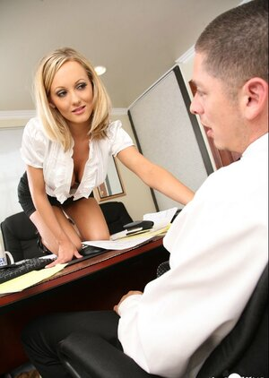 Blonde secretary earns promotion by tempting boss into backdoor sex on table