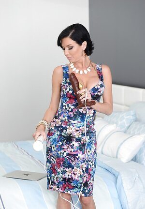 Sultry raven-haired adult star Veronica Avluv plays with big dildo on online camera