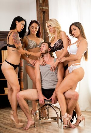 Poor fellow surrounded by four slutty MILFs dressed in sexy lingerie