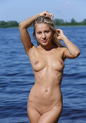 Posh blonde came to the river to feel warm water touching her hot skin