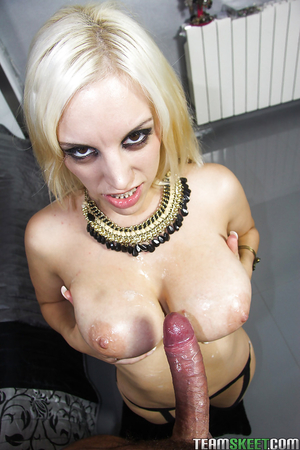 Breasts of platinum blonde Latina are big enough to stroke a cock